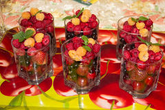 Summer berries in a glass on a tray. royalty free stock images