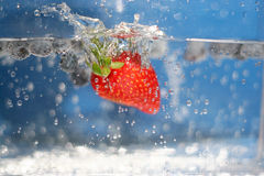 Summer Berries Plunging Royalty Free Stock Photography