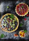 Summer berries tarts on black Royalty Free Stock Image