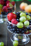 Summer berries in a transparent glass Stock Photography
