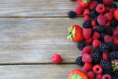 Summer berries on wooden background. Food closeup Royalty Free Stock Photos