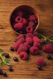 Summer berries on wooden background. Raspberry, blackcurrant, red currant. Summer berries on wooden background. Raspberry, blackcurrant, red currant stock image