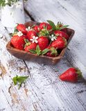 Summer berries on a wooden background Stock Photos
