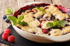 Summer berry cobbler of raspberries and blueberries close up in stock photo