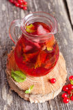 Summer berry cold drink (juice, cocktail, fruit tea) with mint o Stock Image