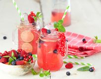 Summer Berry Drink. Lemonade with raspberry and blackberry with royalty free stock photos