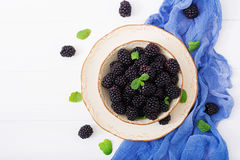 Healthy lifestyle concept, blackberries in bowl. Summer berry on table. Healthy lifestyle concept, blackberries in bowl. Flat lay. Top view Royalty Free Stock Photos