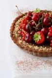 Summer berry tart on white wood background Stock Image