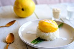 A traditional Thai dessert Mango and Sweet coconut sticky rice. royalty free stock image