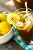 Summer Beverage Iced Tea in Glass With Lemon Royalty Free Stock Photos