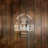 Summer biggest event label logo on wooden background blurry textures Royalty Free Stock Photography