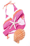 Summer Bikini Concept. With Bikini and Shells Isolated on White with a Clipping Path Royalty Free Stock Photography