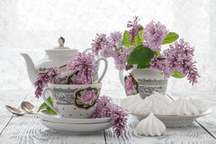 Summer blooming bouquet of lilac and china cup with black tea Stock Photo