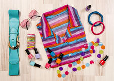 Summer blouse and accessories arranged on the floor. Royalty Free Stock Images