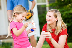 Summer: Blowing Bubbles with Mom Stock Images