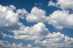Summer blue sky and clouds background. Nice summer day clouds blue sky Royalty Free Stock Photo