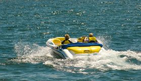 Summer Boating. Adult couple enjoys a power boat ride on the lake Royalty Free Stock Photos