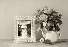 Summer bouquet of flowers and victorian frame on the wooden table with mint background. vintage filtered image. black and white st Royalty Free Stock Photography