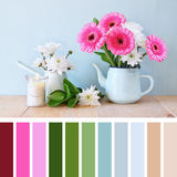 Summer bouquet of flowers on wooden table with mint background. vintage filter with palette color swatches Stock Images
