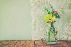 Summer bouquet of flowers on the wooden table with mint background. vintage filtered image Stock Photos