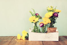 Summer bouquet of flowers on the wooden table with mint background. vintage filtered image Stock Images