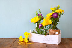 Summer bouquet of flowers on the wooden table with mint background. vintage filtered image Stock Photo