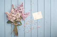 Summer bouquet of gentle blooming lilac with card Stock Photos