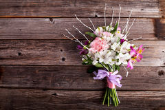 Summer bouquet from gillyflowers and alstroemeria on old wooden Stock Photos
