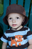 Summer boy. Young toddler boy wearing a brown sun hat and striped outfit in the summer Royalty Free Stock Photo