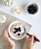 Summer breakfast with blackberry on white royalty free stock images