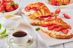 Summer breakfast - croissant sandwiches and coffee Stock Photo