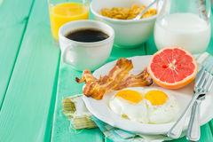 Summer breakfast - eggs, bacon, toast, jam, coffee, juice. Summer breakfast - eggs, bacon, toast, jam coffee juice copy space Stock Photo