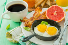 Summer breakfast - eggs, bacon, toast, jam, coffee, juice. Summer breakfast - eggs, bacon, toast, jam coffee juice copy space Royalty Free Stock Photos