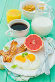 Summer breakfast - eggs, bacon, toast, jam, coffee, juice. Summer breakfast - eggs, bacon, toast, jam coffee juice copy space Stock Image