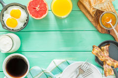 Summer breakfast - eggs, bacon, toast, jam, coffee, juice. Summer breakfast - eggs, bacon, toast, jam coffee juice copy space Royalty Free Stock Images