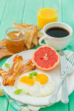Summer breakfast - eggs, bacon, toast, jam, coffee, juice. Summer breakfast - eggs, bacon, toast, jam coffee juice copy space Stock Photography