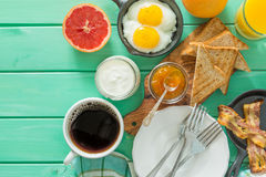 Summer breakfast - eggs, bacon, toast, jam, coffee, juice. Summer breakfast - eggs, bacon, toast, jam coffee juice copy space Royalty Free Stock Image
