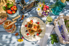 Summer breakfast in the garden with fruit toast with honey Stock Photography
