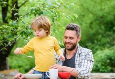 Summer breakfast. Healthy food concept. Father son eat food and have fun. Menu for children. Family enjoy homemade meal stock image