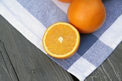 Summer breakfast, oranges on a royalty free stock photography