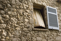 Summer Breeze. Window in a stone wall with curtain blowing in the breeze Stock Photography