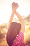 Summer breeze. Woman enjoy in summer breeze, back shot, outdoor shot on glade royalty free stock image