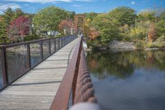 A summer on a bridge. I took this photo in Maine, it is called the Historic Bridge in Brunswick, the masterpiece stands strong. It was during fall, it had not Royalty Free Stock Photos
