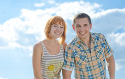 Summer bright smile. Man and women on a background of blue sky Stock Photo