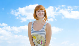 Summer bright smile. The young girl smiles against the blue sky broadly Stock Photos