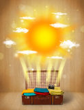 Summer bright sun with clouds and tourist bag Royalty Free Stock Photos