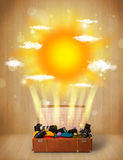 Summer bright sun with clouds and tourist bag Royalty Free Stock Images