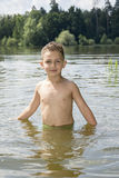 Summer bright sunny day boy is bathed in the river. Stock Photography