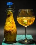 Summer bright yellow fruit cocktail, glass bottle , lemonade, studio photo Royalty Free Stock Photography