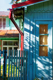 Summer brightly colored house with a wicket royalty free stock images